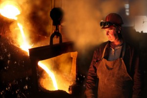 Hard work in a foundry, melting iron
